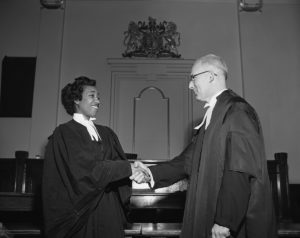 Violet King Henry shakes hands with senior partner at her 1954 bar call.
